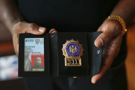 The badge and identification card of retired NYPD detective Harold Thomas are seen in West Hempstead, New York December 17, 2014. REUTERS/Shannon Stapleton
