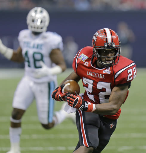Louisiana-Lafayette running back Elijah McGuire (22) breaks loose in front of Tulane defensive end Royce LaFrance (48) during the first half of the New Orleans Bowl NCAA college football game, Saturday, Dec. 21, 2013, in New Orleans. (AP Photo/Bill Haber)