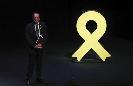 Catalan leader Quim Torra walks past a yellow ribbon after giving a speech at Catalonia's National Theatre (TNC) in Barcelona, Spain September 4, 2018. REUTERS/Albert Gea