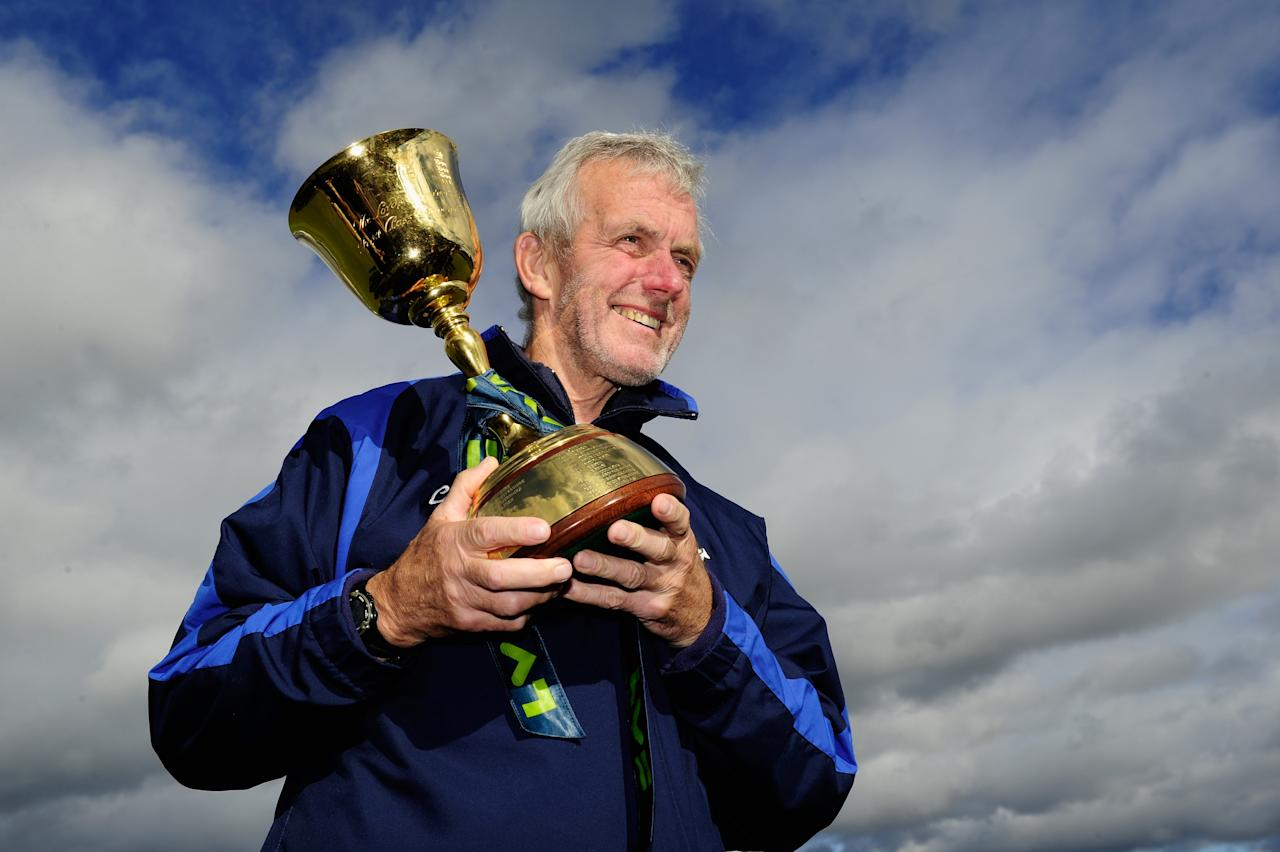 CHESTER-LE-STREET, ENGLAND - SEPTEMBER 19:  Durham coach Geoff Cook holds the trophy after winning the LV County Championship Division One title after day three of the LV County Championship Division One match between Durham and Nottinghamshire at The Riverside on September 19, 2013 in Chester-le-Street, England.  (Photo by Stu Forster/Getty Images)