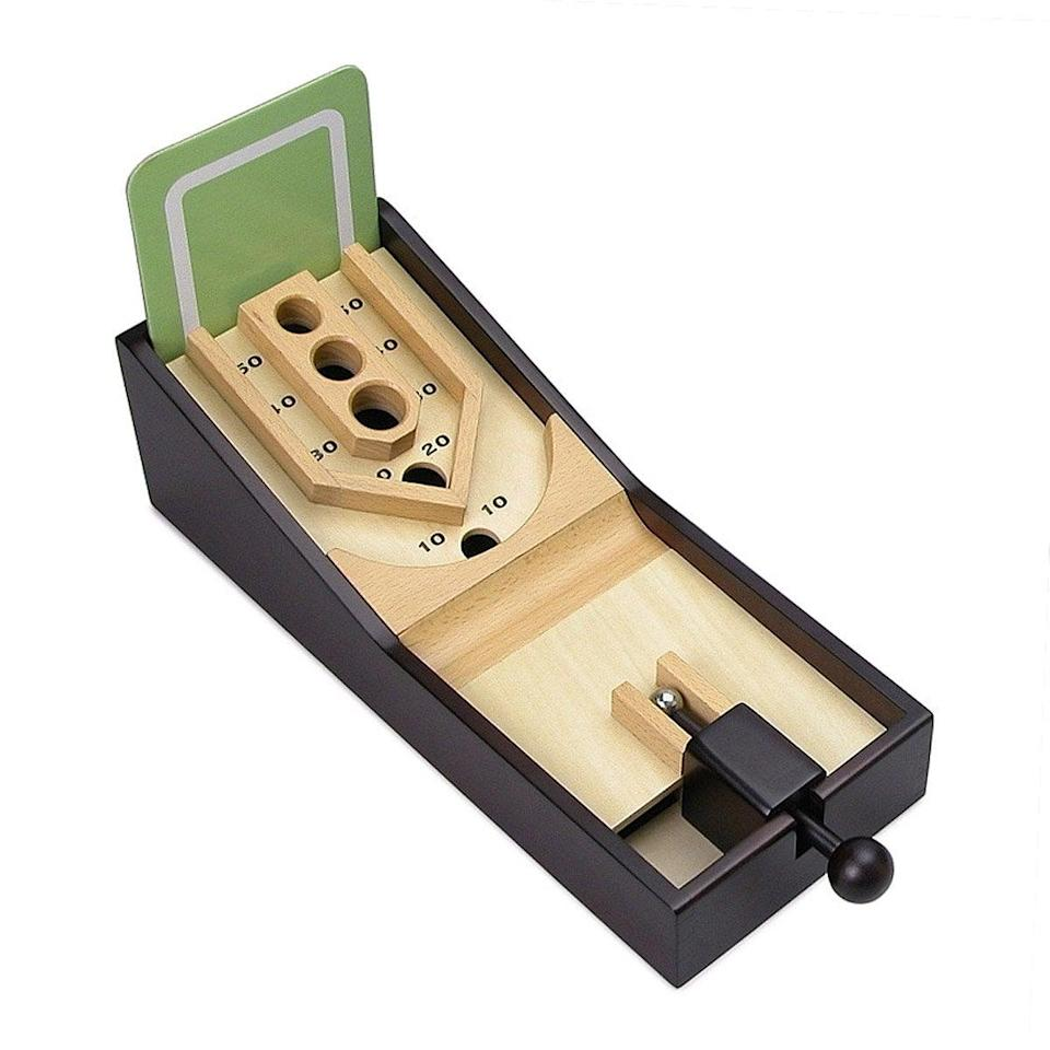 <p>Step up their work-from-home set up with the<span>Desktop Skee Ball</span> ($35).</p>