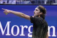 Stefanos Tsitsipas, of Greece, speaks with an official during a match with Carlos Alcaraz, of Spain, during the third round of the US Open tennis championships, Friday, Sept. 3, 2021, in New York. (AP Photo/Seth Wenig)