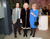 """<p>The Duchess of Cornwall wore a raspberry velvet coat dress and large stone drop earrings to a reception to launch the """"Glorious Grandparents"""" initiative in London. </p>"""