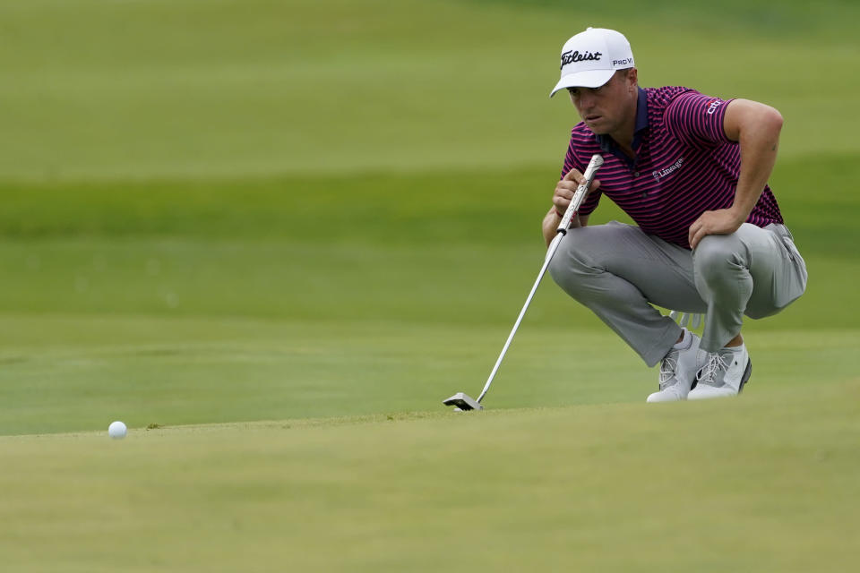Justin Thomas lines up a putt before sinking a birdie on the 10th green in the third round at the Northern Trust golf tournament, Saturday, Aug. 21, 2021, at Liberty National Golf Course in Jersey City, N.J. (AP Photo/John Minchillo)