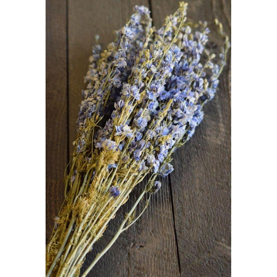 "<p>curiouscountrycreations.com</p><p><strong>$16.99</strong></p><p><a href=""https://www.curiouscountrycreations.com/dried-light-blue-larkspur-delphinium-p-962.html?search=dried+larkspur"" rel=""nofollow noopener"" target=""_blank"" data-ylk=""slk:Shop Now"" class=""link rapid-noclick-resp"">Shop Now</a></p><p>Spray-painted branches in pastel hues or dried branchy florals like larkspur make a longer lasting, colorful centerpiece. Mix with some clipped branches from the garden!</p>"