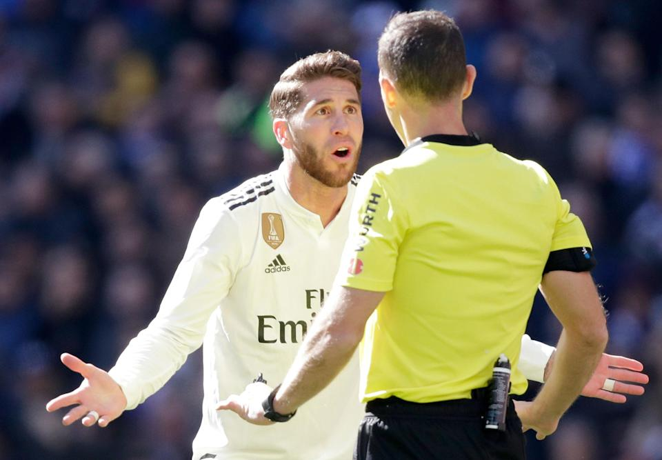 """<span>It was that kind of day for </span><a class=""""link rapid-noclick-resp"""" href=""""https://sports.yahoo.com/soccer/teams/real-madrid/"""" data-ylk=""""slk:Real Madrid"""">Real Madrid</a><span> and its captain, </span><a class=""""link rapid-noclick-resp"""" href=""""https://sports.yahoo.com/soccer/players/373142/"""" data-ylk=""""slk:Sergio Ramos"""">Sergio Ramos</a><span> (left), who was sent off late in Sunday's 2-1 loss to Girona.(David S. Bustamante/Getty)</span>"""