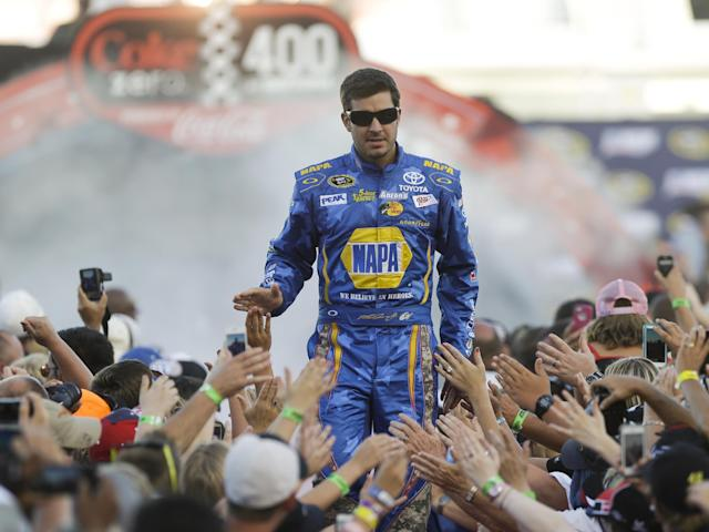 In this July 6, 2013, photo, Martin Truex Jr. greets fans during driver introductions before the NASCAR Sprint Cup auto race at Daytona International Speedway in Daytona Beach, Fla. NAPA Auto Parts said Thursday, Sept. 19, 2013, it will end its multimillion-dollar sponsorship of Michael Waltrip Racing at the end of the year, the latest fallout from the team's attempt to manipulate a race to get Truex into NASCAR's version of the playoffs. NAPA is Truex's primary sponsor and in the first year of a three-year extension announced last August. The deal ran through the 2015 season and is believed to be worth at least $15 million a year. (AP Photo/John Raoux)