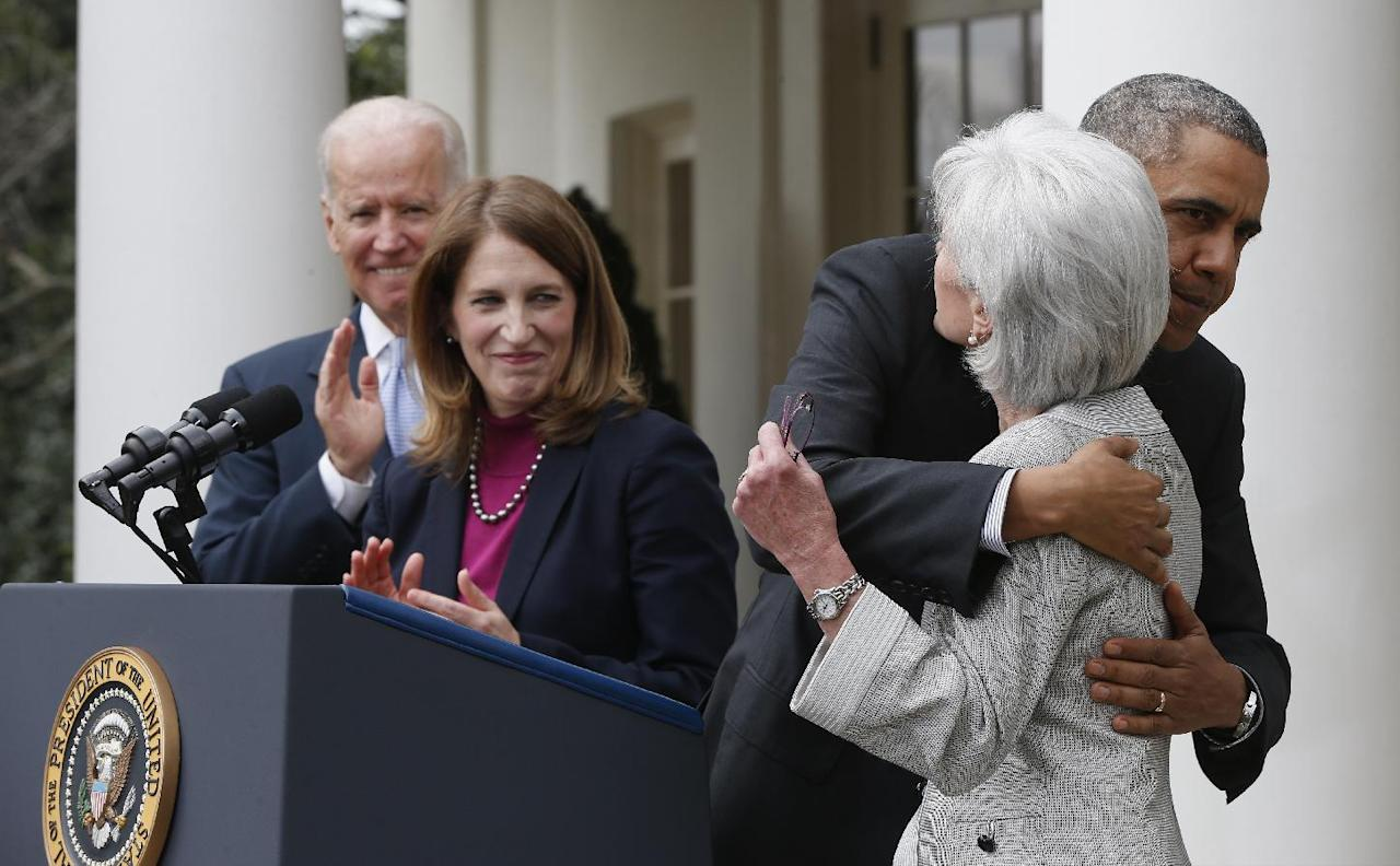 President Barack Obama hugs outgoing Health and Human Services Secretary Kathleen Sebelius as he stands with Vice President Joe Biden and his nominee to be her replacement, Budget Director Sylvia Mathews Burwell, Friday, April 11, 2014, in the Rose Garden f the White House in Washington. The moves come just over a week after sign-ups closed for the first year of insurance coverage under the so-called Obamacare law.(AP Photo/Charles Dharapak)
