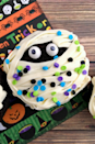 """<p>Enlist your kids to help decorate these <a href=""""https://www.amazon.com/Wilton-710-685-Halloween-Cell-Sprinkle/dp/B00DQR4JLK?tag=syn-yahoo-20&ascsubtag=%5Bartid%7C10050.g.1366%5Bsrc%7Cyahoo-us"""" rel=""""nofollow noopener"""" target=""""_blank"""" data-ylk=""""slk:sprinkle-topped"""" class=""""link rapid-noclick-resp"""">sprinkle-topped</a> treats.</p><p><strong>Get the recipe at <a href=""""http://www.frugalmomeh.com/2016/09/mummy-cupcakes.html#_a5y_p=5770517"""" rel=""""nofollow noopener"""" target=""""_blank"""" data-ylk=""""slk:Frugal Mom Eh"""" class=""""link rapid-noclick-resp"""">Frugal Mom Eh</a>.</strong></p><p><a class=""""link rapid-noclick-resp"""" href=""""https://www.amazon.com/dp/B001K26ZPG/?tag=syn-yahoo-20&ascsubtag=%5Bartid%7C10050.g.1366%5Bsrc%7Cyahoo-us"""" rel=""""nofollow noopener"""" target=""""_blank"""" data-ylk=""""slk:SHOP CUPCAKE PANS"""">SHOP CUPCAKE PANS</a></p>"""