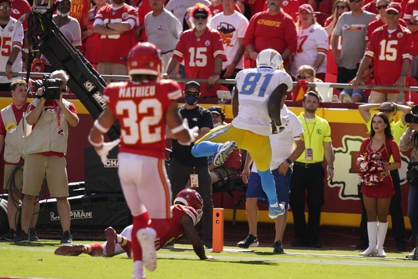 Los Angeles Chargers' Mike Williams (81) makes a touchdown reception during the second half of an NFL football game against the Kansas City Chiefs, Sunday, Sept. 26, 2021, in Kansas City, Mo. Los Angeles won 30-24. (AP Photo/Charlie Riedel)