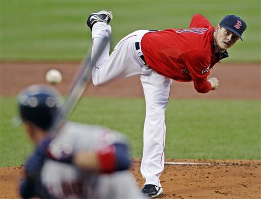 Boston Red Sox starting pitcher Clay Buchholz delivers to Cleveland Indians' Asdrubal Cabrera during the first inning of a baseball game at Fenway Park in Boston, Friday, May 11, 2012. (AP Photo/Charles Krupa)