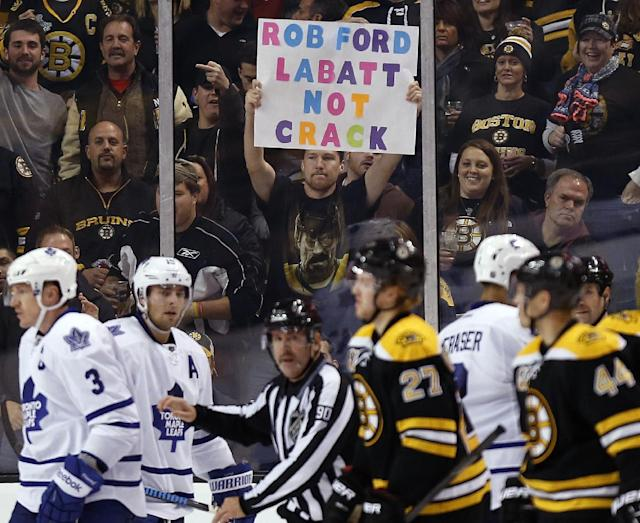 A fan holds a sign in reference to Toronto Mayor Rob Ford in the third period of an NHL hockey game between the Boston Bruins and the Toronto Maple Leafs in Boston, Saturday, Nov. 9, 2013. The Bruins won 3-1. (AP Photo/Michael Dwyer)