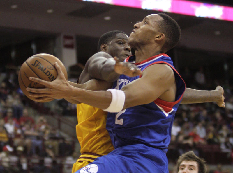 Philadelphia 76ers' Evan Turner, right, is fouled by Cleveland Cavaliers' Anthony Bennett during the second quarter of an NBA preseason basketball game Monday, Oct. 21, 2013, in Columbus, Ohio. (AP Photo/Jay LaPrete)