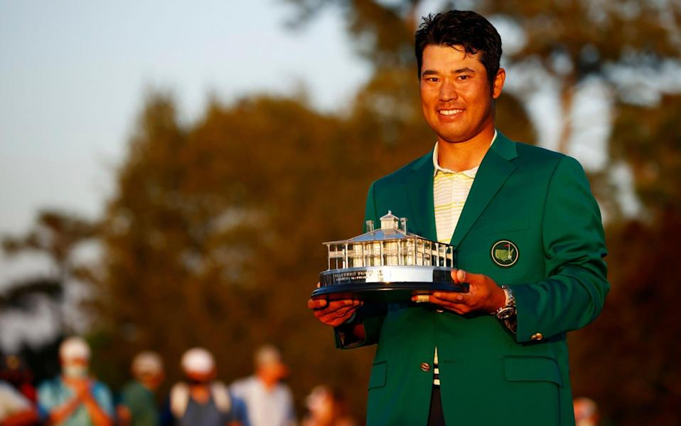 Hideki Matsuyama of Japan poses with the Masters Trophy during the Green Jacket Ceremony after winning the Masters at Augusta - Getty