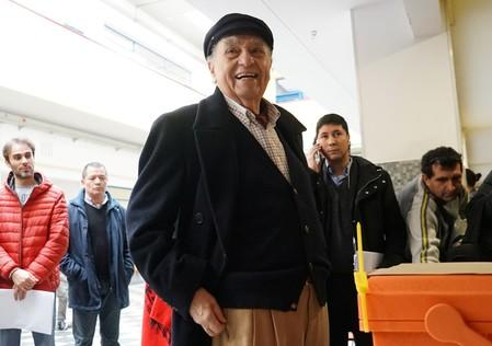 Uruguay's former President Julio Maria Sanguinetti of the Colorado Party smiles before casting his vote during primary elections ahead of the presidential elections later this year, in Montevideo