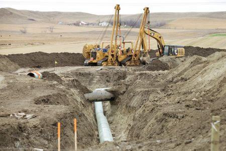 FILE PHOTO: Construction equipment sits near a Dakota Access Pipeline construction site off County Road 135 near the town of Cannon Ball