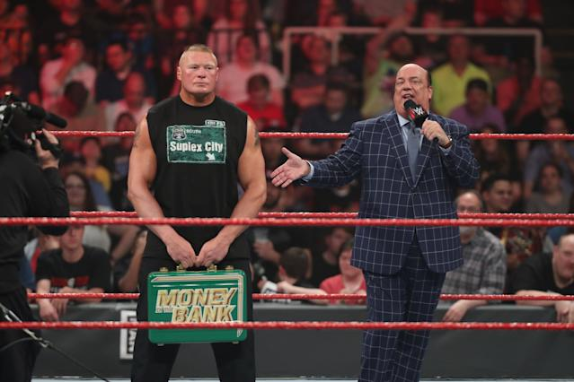 "Paul Heyman addresses the crowd as Brock Lesnar holds the ""Money in the Bank"" briefcase. (Photo courtesy of WWE)"