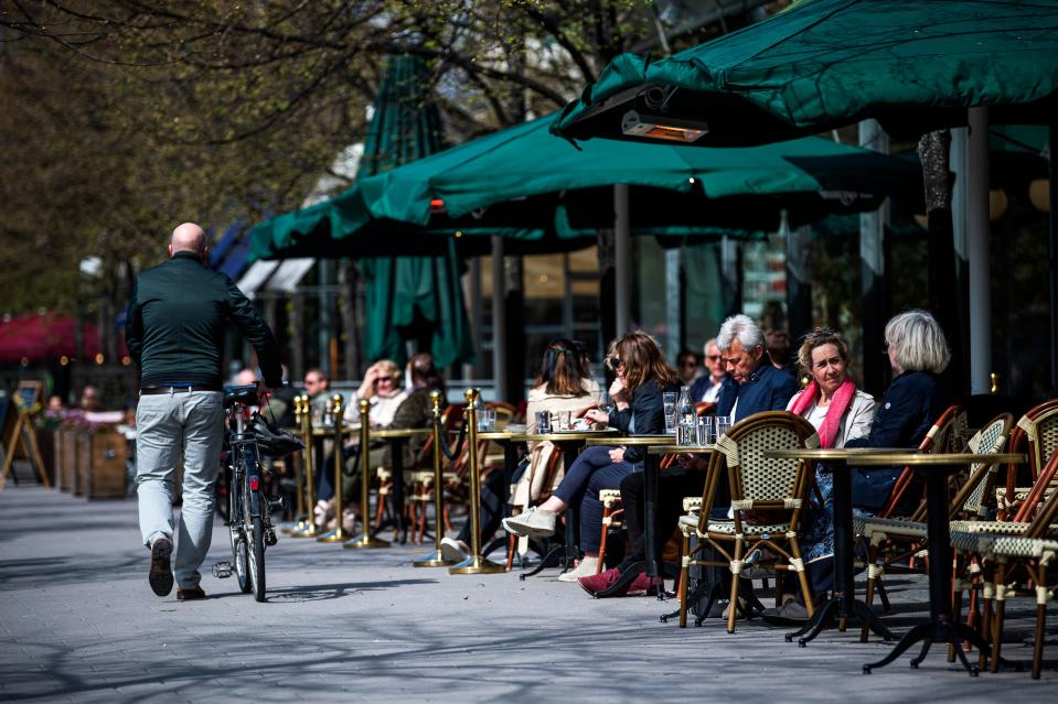 People sit in a restaurant in Stockholm on May 8, 2020, amid the coronavirus COVID-19 pandemic. (Photo by Jonathan NACKSTRAND / AFP) (Photo by JONATHAN NACKSTRAND/AFP via Getty Images)