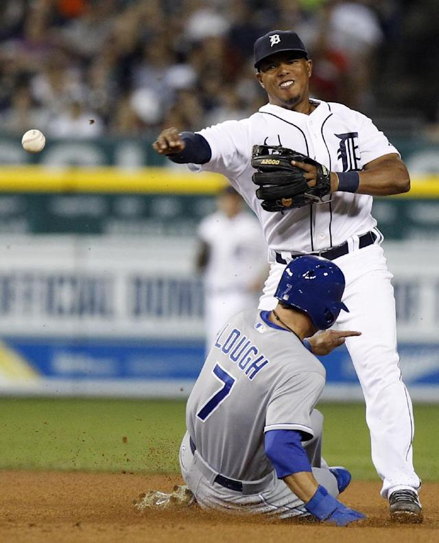 Detroit Tigers' Ramon Santiago turns the ball after getting a force out on Kansas City Royals' David Lough in the seventh inning during the second game of a doubleheader baseball game, Friday, Aug. 16, 2013, in Detroit. Santiago's throw was too late to get Royals' Emilio Bonifacio at first base. (AP Photo/Duane Burleson)