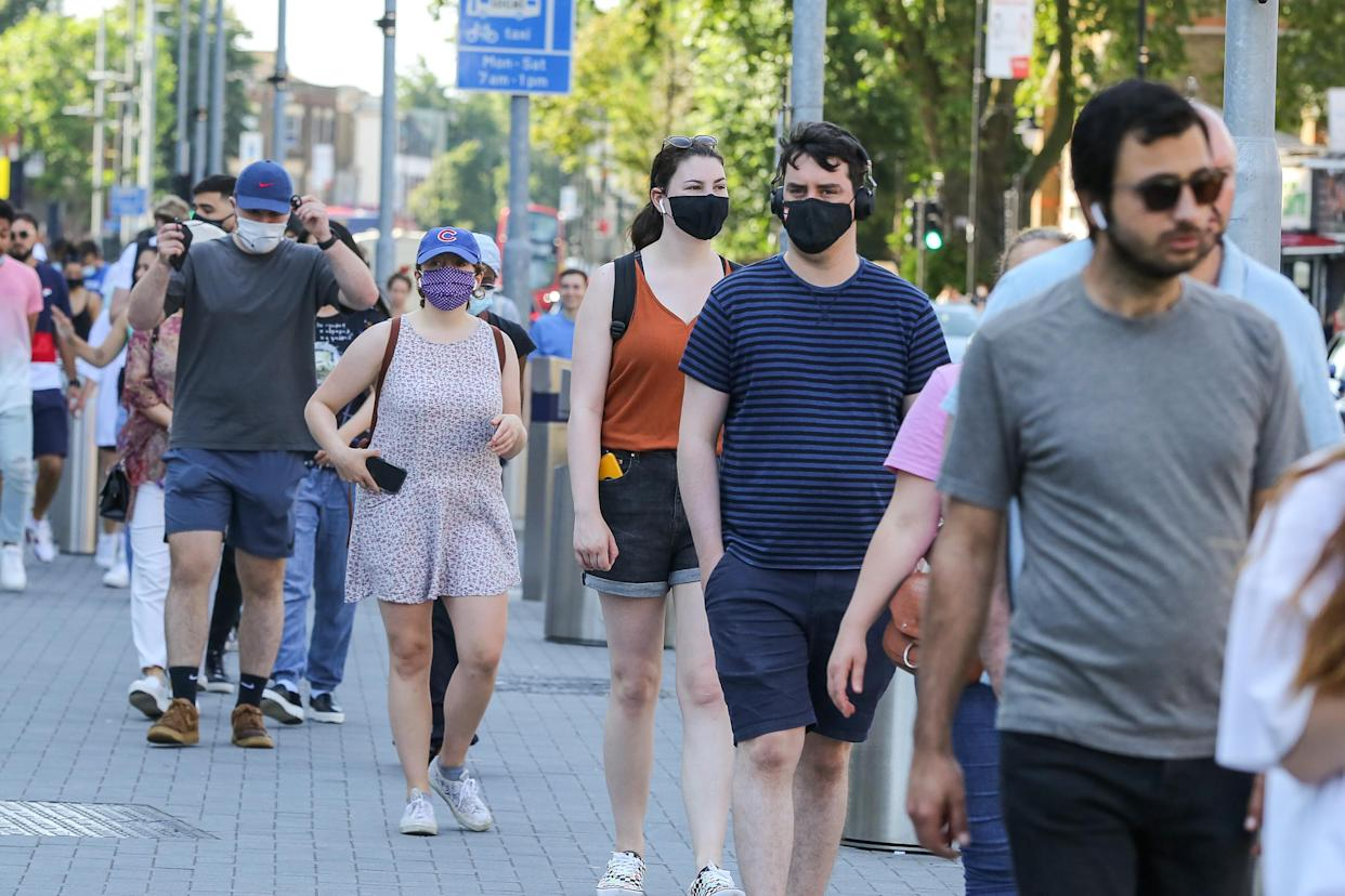 People wearing face masks as a precaution against the spread of covid-19 seen outside Tottenham Hotspur Stadium in north London to receive their Covid-19 vaccine during a mass vaccination event, as UK Covid-19 vaccination drive continues. (Photo by Steve Taylor / SOPA Images/Sipa USA)