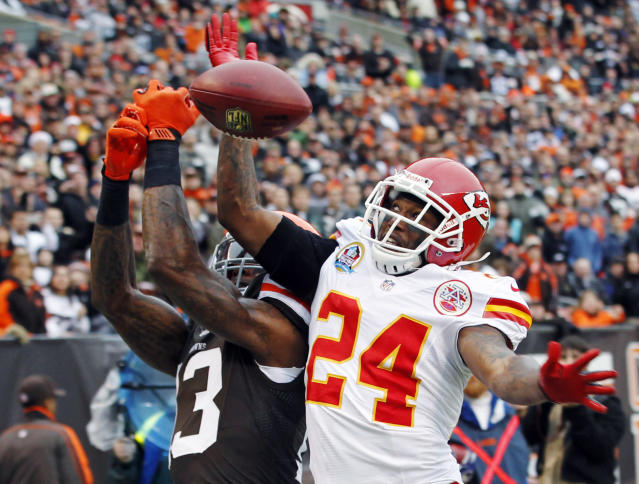 FILE - In this Dec. 9, 2012, file photo, Kansas City Chiefs cornerback Brandon Flowers (24) breaks up a pass in the end zone intended for Cleveland Browns wide receiver Josh Gordon in the first quarter of an NFL football game in Cleveland. Kansas City released Flowers on Friday, June 13, 2014, after three weeks of voluntary workouts in which the former starter was conspicuously absent. (AP Photo/Tony Dejak, File)