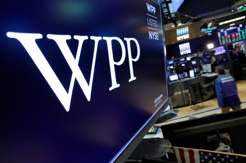 The logo for WPP appears above a trading post on the floor of the New York Stock Exchange, Wednesday, April 4, 2018. Shares in WPP, the world's largest advertising agency, have fallen after an announcement that the board is investigating an allegation of personal misconduct against its chief executive, Martin Sorrell. (AP Photo/Richard Drew)