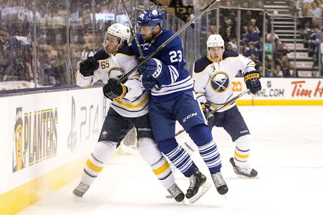 Toronto Maples' Trevor Smith, center, checks Buffalo Sabres' Brian Flynn, left, during the first period of an NHL hockey game, Saturday, Nov. 16, 2013 in Toronto. (AP Photo/The Canadian Press, Chris Young)