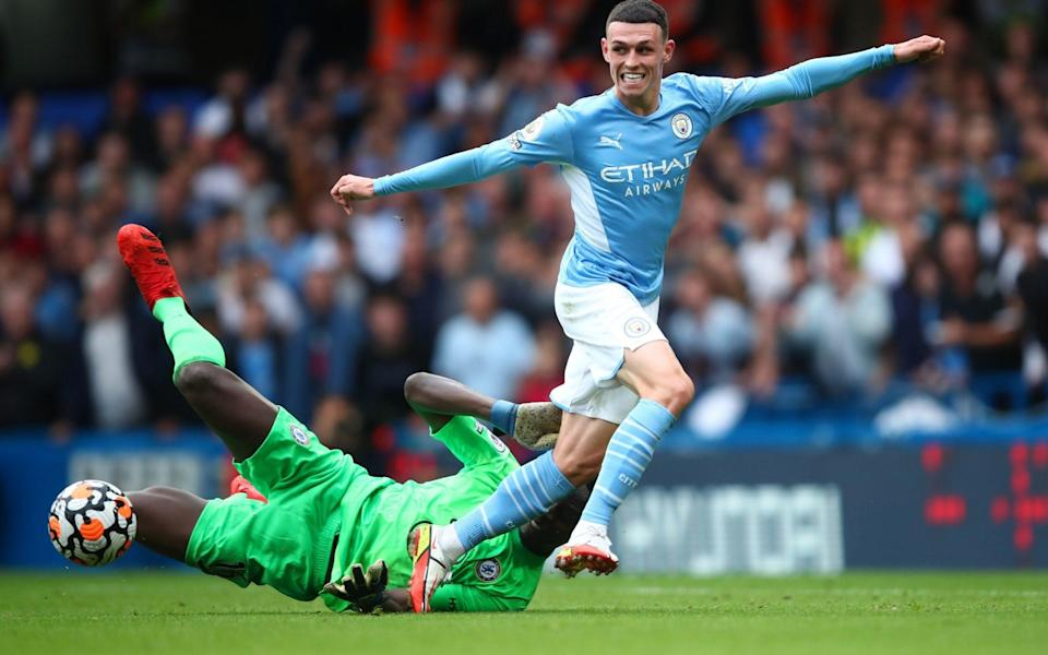 Phil Foden of Manchester City in action with Edouard Mendy of Chelsea. - Marc Atkins/Getty Images