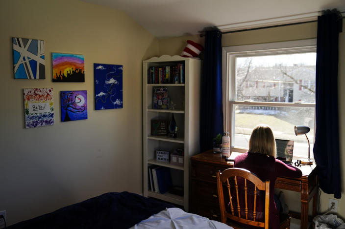 """Rebekah Bruesehoff, 14, works on school assignments at home in New Jersey, Friday, Feb. 26, 2021. While New Jersey has a trans-inclusive sports policy, the field hockey player is distressed by proposed bans elsewhere – notably measures that might require girls to verify their gender. """"I know what it's like to have my gender questioned,"""" Rebekah said. """"It's invasive, embarrassing. I don't want others to go through that."""" (AP Photo/Matt Rourke)"""