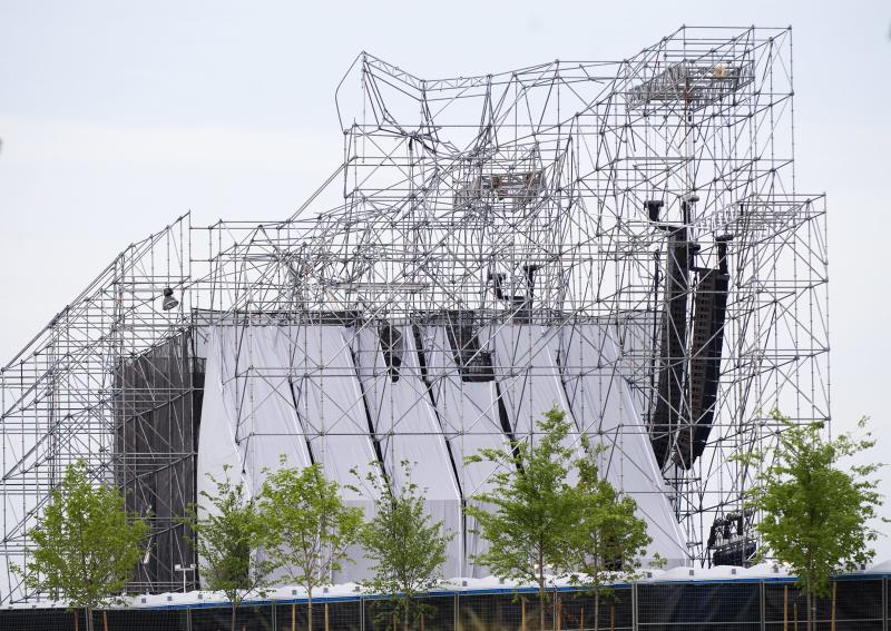 A stage intended for a Radiohead concert is collapsed at Downsview Park in Toronto on Saturday, June 16, 2012. Toronto paramedics say one person is dead and another is seriously hurt after the stage collapsed while setting up for a Radiohead concert. They say two other people were injured and are being assessed. (AP Photo/The Canadian Press, Nathan Denette)