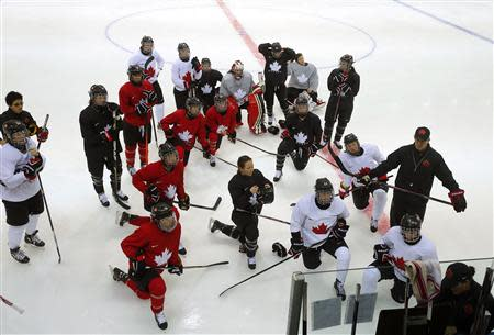 Members of the Canadian women's ice hockey team attend a practice session ahead of the 2014 Sochi Winter Olympics