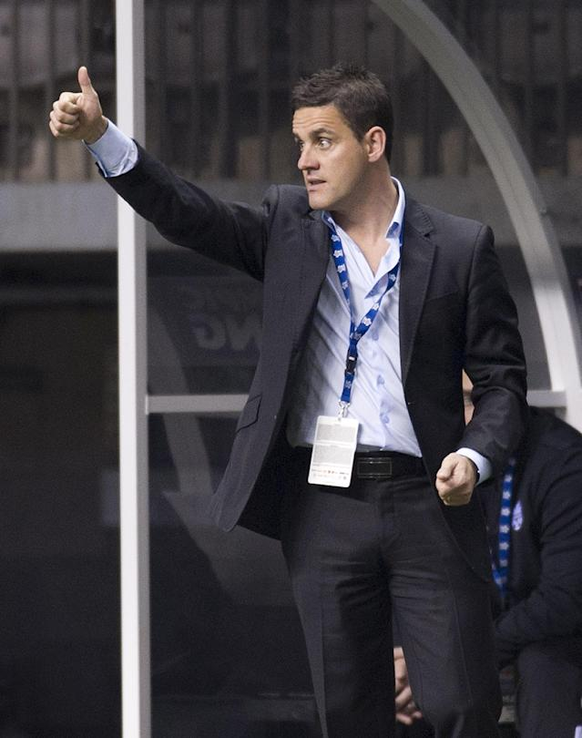 VANCOUVER, CANADA - JANUARY 21: John Herdman, head coach of Canada gestures to his players during the second half of the 2012 CONCACAF Women's Olympic Qualifying Tournament action against Cuba at BC Place on January 21, 2012 in Vancouver, British Columbia, Canada. (Photo by Rich Lam/Getty Images)