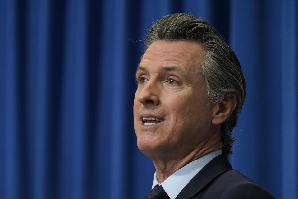 FILE - In this Jan. 8, 2021, file photo, California Gov. Gavin Newsom speaks during a news conference in Sacramento, Calif. Gov. Newsom could likely face a recall election this year. On Tuesday, Feb. 16, 2021, the California Legislature passed a bill that would require all active registered voters receive a ballot in the mail for that and any other election that happens this year. (AP Photo/Rich Pedroncelli, Pool, File)