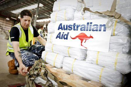 Officer in Charge of Air Movements at RAAF Amberley, Flying Officer Don Ninness, prepares Australian Aid before it is loaded onto a No. 36 Squadron C-17A aircraft destined for Cyclone Winston-affected Fiji at RAAF Base Amberley near Brisbane, February 23, 2016. REUTERS/Australian Defence Force/Handout via Reuters