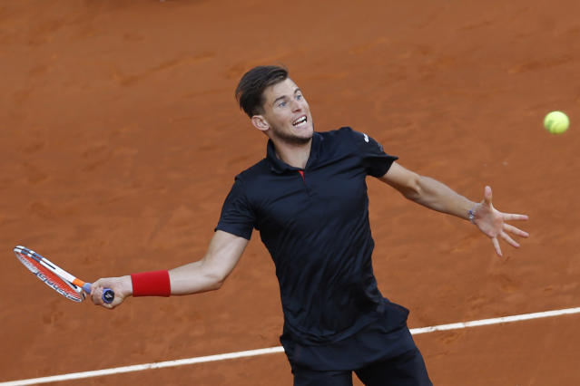 FILE - In this May 13, 2018, file photo, Dominic Thiem, of Austria, returns the ball to Alexander Zverev, of Germany, during the men's final of the Madrid Open Tennis tournament in Madrid, Spain. Thiem will be competing in the French Open tennis tournament that begins on Sunday, May 27. (AP Photo/Francisco Seco, File)