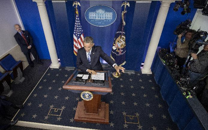 US President Barack Obama speaks during a press conference in the briefing room of the White House on December 19, 2014 in Washington, DC (AFP Photo/Brendan Smialowski)