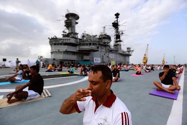 <p>Members of Indian Navy perform yoga on the flight deck of INS Viraat, an Indian Navy's decommissioned aircraft carrier during International Yoga Day in Mumbai, India, June 21, 2017. (Photo: Danish Siddiqui/Reuters) </p>