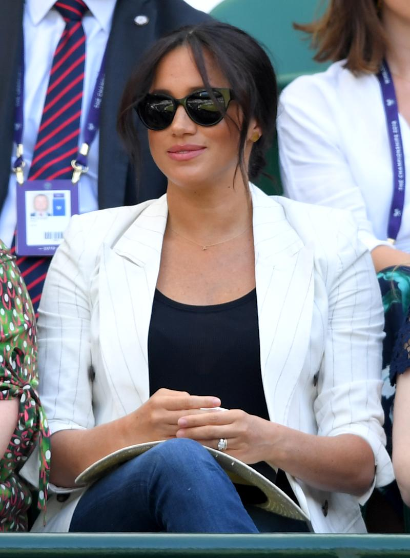 LONDON, ENGLAND - JULY 04: Meghan, Duchess of Sussex attends day 4 of the Wimbledon Tennis Championships at the All England Lawn Tennis and Croquet Club on July 04, 2019 in London, England. (Photo by Karwai Tang/Getty Images)