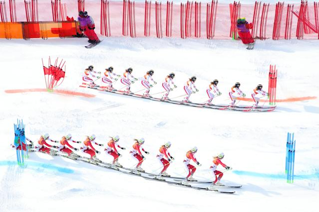 <p>Multiple exposures were combined in camera to produce this image.) Denise Feierabend of Switzerland (bottom) and Katharina Liensberger of Austria compete during the Alpine Team Event big final on day 15 of the PyeongChang 2018 Winter Olympic Games at Yongpyong Alpine Centre on February 24, 2018 in Pyeongchang-gun, South Korea. (Photo by Alexander Hassenstein/Getty Images) </p>