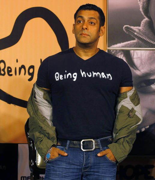 FILE – In this Jan. 17, 2013 file photo, Bollywood star Salman Khan poses wearing a Being Human t-shirt during the launch of Being Human's first flagship store in Mumbai, India. An Indian judge on Thursday, Dec. 5, 2013, ordered a fresh trial against Khan on a homicide charge for a fatal road accident more than 11 years ago, and said all the witnesses would be re-examined. The pre-trial is set for Dec. 23. (AP Photo/Rafiq Maqbool, File)