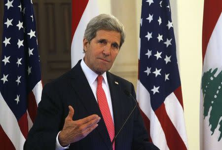 U.S. Secretary of State John Kerry gestures as he speaks during a news conference after meeting with Lebanon's Prime Minister Tammam Salam at the government palace in Beirut
