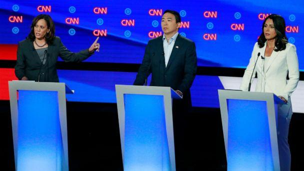 PHOTO: Senator Kamala Harris speaks as entrepreneur Andrew Yang and Rep. Tulsi Gabbard listen on the second night of the second presidential debate in Detroit, July 31, 2019. (Lucas Jackson/Reuters)