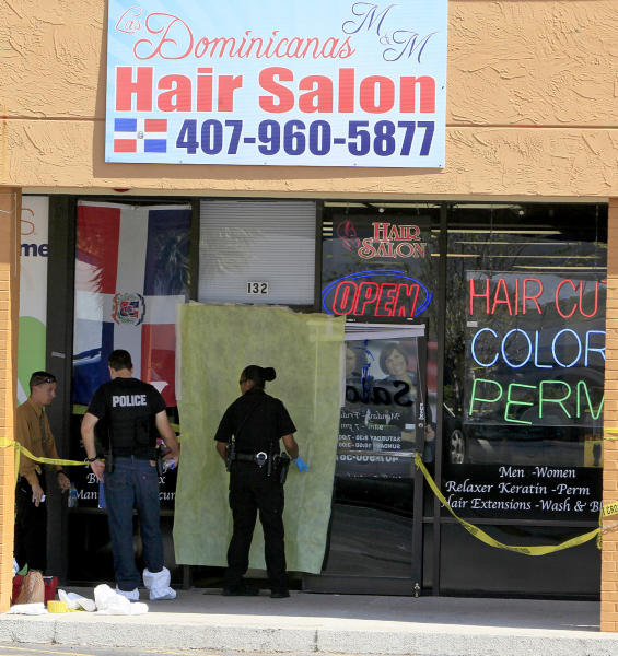 Authorities investigate at the scene of the shooting at Las Dominicanas M&M Hair Salon in Winter Park, Fla., Thursday, Oct. 18, 2012. A gunman opened fire in a central Florida beauty salon Thursday, killing three women and wounding a fourth before killing himself at a nearby home, police said. The shooting appeared to be part of a domestic dispute. (AP Photo/Julie Fletcher)
