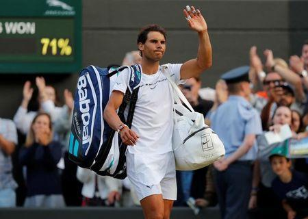 Tennis - Wimbledon - London, Britain - July 10, 2017 Spain's Rafael Nadal waves as he walks off court after losing his fourth round match against Luxembourg's Gilles Muller REUTERS/Matthew Childs