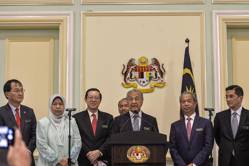Dr Mahathir and Muhyiddin said the police should be allowed to conduct their investigations. — Picture by Miera Zulyana