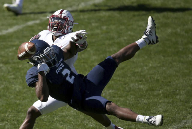 "Stanford's cornerback <a class=""link rapid-noclick-resp"" href=""/ncaaf/players/240494/"" data-ylk=""slk:Terrence Alexander"">Terrence Alexander</a>, back, breaks up a play by Rice's running back <a class=""link rapid-noclick-resp"" href=""/ncaaf/players/245280/"" data-ylk=""slk:Austin Walter"">Austin Walter</a> during the opening game of the U.S. college football season in Sydney, Sunday, Aug. 27, 2017. (AP Photo/Rick Rycroft)"