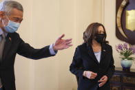 U.S. Vice President Kamala Harris, right, is welcomed by Singapore's Prime Minister Lee Hsien Loong at the Istana in Singapore Monday, Aug. 23, 2021. (Evelyn Hockstein/Pool Photo via AP)