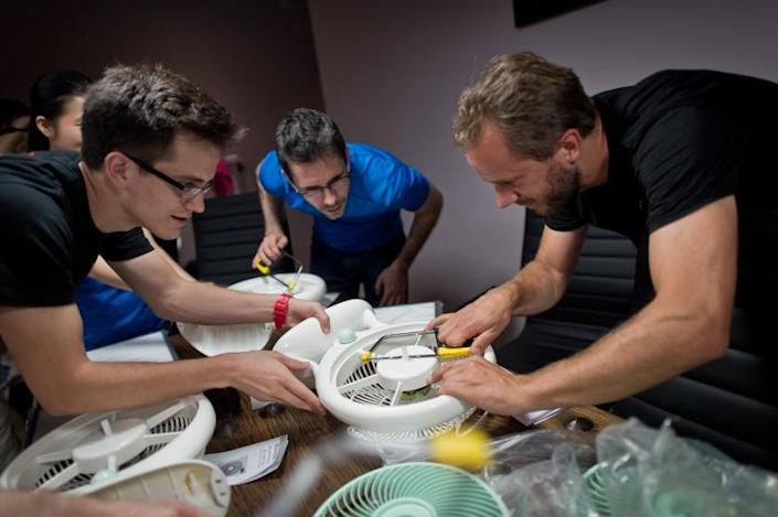 """Thomas Talhelm, center, led workshops in Beijing to demonstrate how to make a simple, DIY air purifier. <span class=""""copyright"""">(James Le)</span>"""