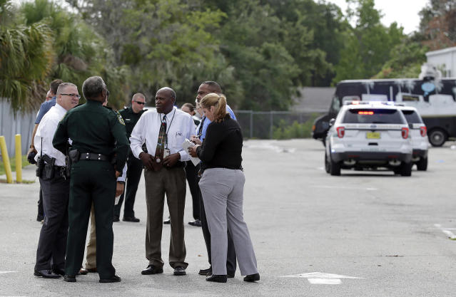 "<p>Authorities confer, Monday, June 5, 2017, near Orlando, Fla. Law enforcement authorities said there were ""multiple fatalities"" following a Monday morning shooting in an industrial area near Orlando. On its officials Twitter account Monday morning, the Orange County Sheriff's Office said the ""situation"" has been contained. They said Orange County Sheriff Jerry Demmings will make a statement ""as soon as info is accurate."" (AP Photo/John Raoux) </p>"