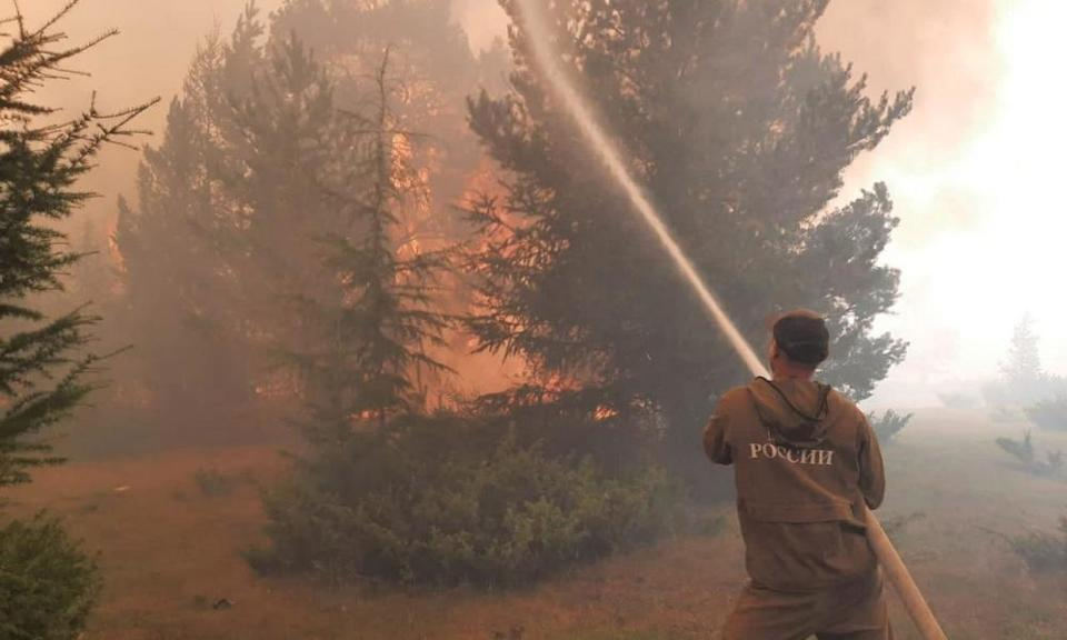 A firefighter battles wildfires in Yakutia, Russia
